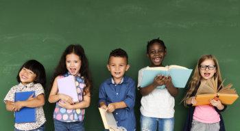 children holding a book